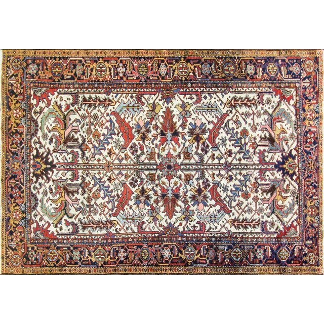Great color combinations, vegetable dyed wool Persian Heriz, circa 1920. A charming antique Persian Heriz carpet it has a...