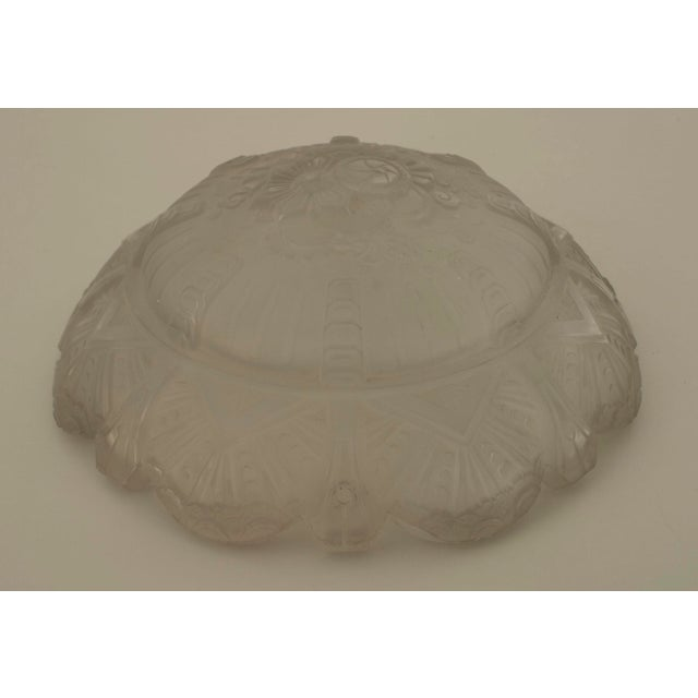 French Art Deco (circa 1925) round pendant form frosted glass bowl form chandeliers with A scalloped form edge with a...
