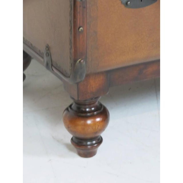 Leather trunk with metal hardware.