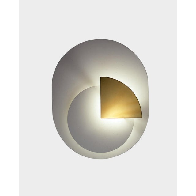 Wall sconce, model 1324, originally designed by Pia Guidetti for Lumi in 1976. New production using original production...