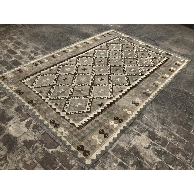 This is a great hand-woven Kilim rug, made in Pakistan. This is a newly woven Chobi Kilim rug, that is done in the...