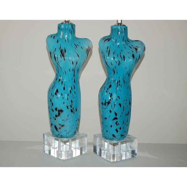 Murano glass Venus Table lamps in SEA BLUE peppered with BLACK, handblown into a mold. Set on large Lucite blocks, they...