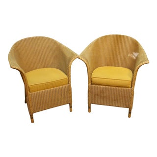 Mid-20th Century Arm Chairs by Lloyd Loom- A Pair For Sale