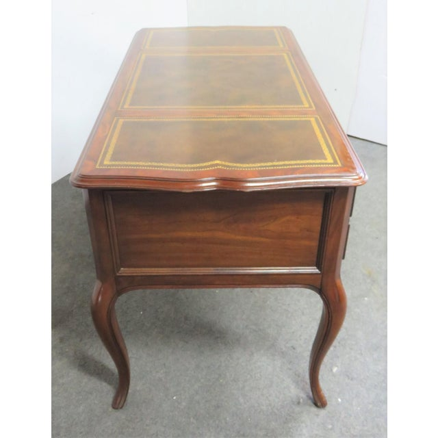 Sligh French Style Leathertop Writing Desk, 3 section leather top with gold tool decoration, 4 drawers including file drawer.