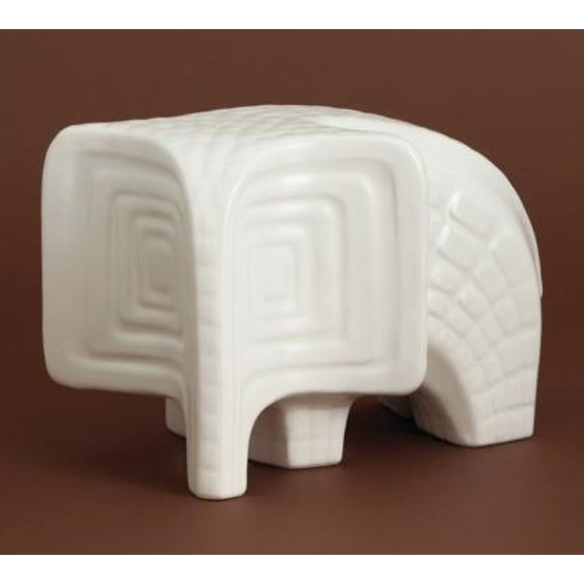 Gorgeous elephant from Jonathan Adler's Menagerie collection, made of high fired stoneware with a matte white glaze....