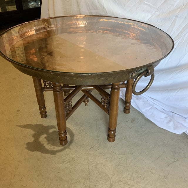 Stunning solid copper bowl tray with glass too. Cool ring handles on each side. Wood carved base that is very sturdy. The...