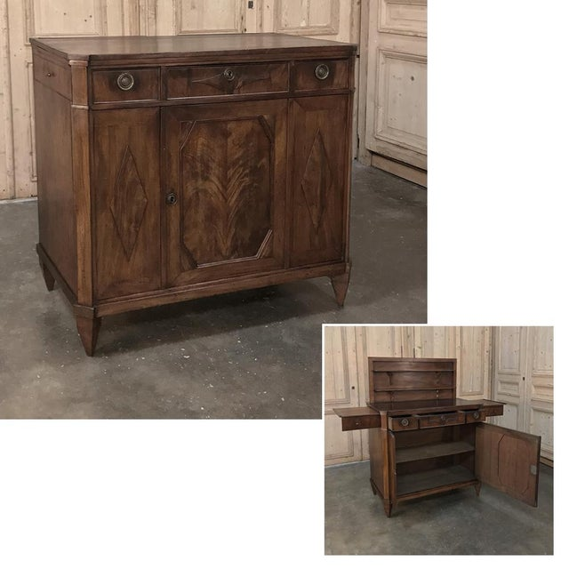 18th Century English Mahogany Pop Up Serving Buffet is an amazing work of ingenuity, craftsmanship, and sheer natural...