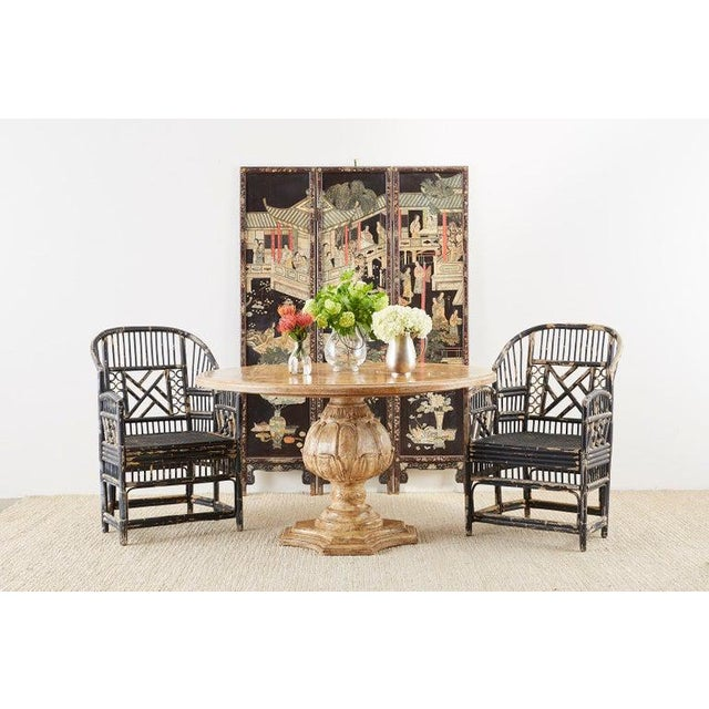 Fantastic set of four bamboo rattan lacquered armchairs made in the Brighton Pavilion Chinese Chippendale taste. Featuring...