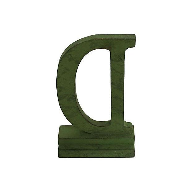Vintage wood department store letter D in original green paint, found in Buffalo, NY.