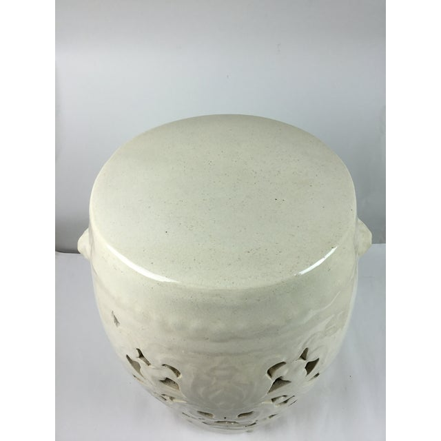 Vintage white garden stool in pierced white pottery. Classic white on white with pierced Asian design and handles on both...