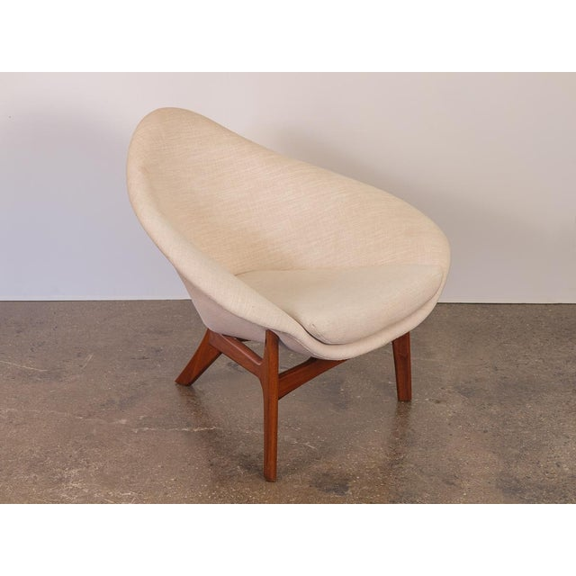 Rarely seen Adrian Pearsall Coconut Chair on the three-legged teak base. A voluptuous, triangular profile with soft...