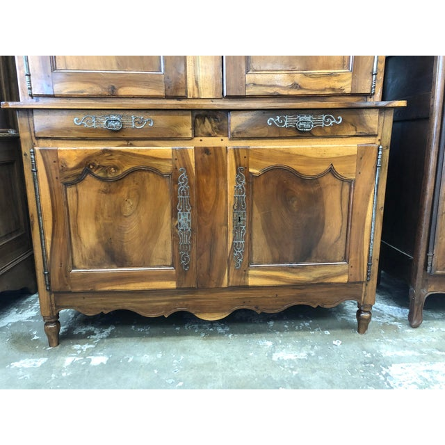 19th century French Louis XV solid walnut cabinet. French Provincial figured deux corps buffet consisting of a cornice top...