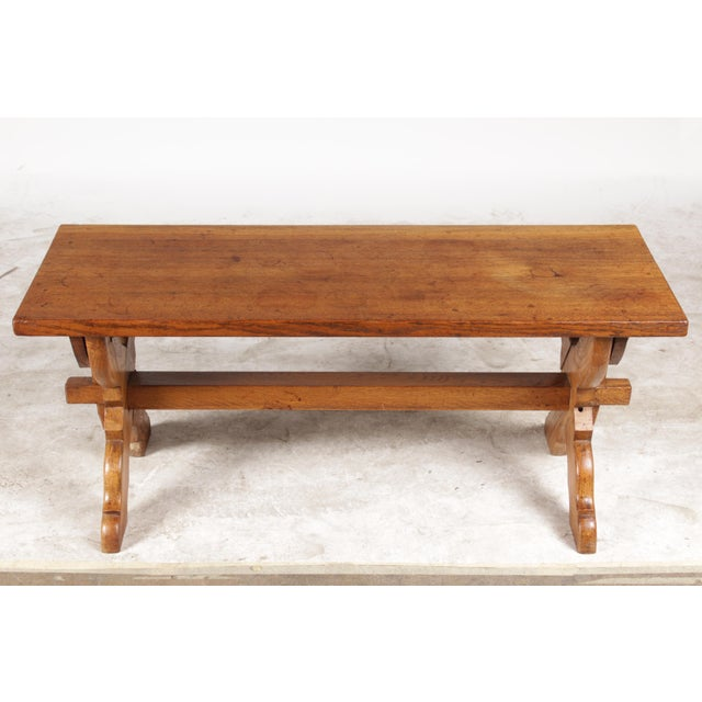 Vintage X-Leg coffee table from Belgium featuring solid oak construction, cross legs, wood dowels and top with worn...