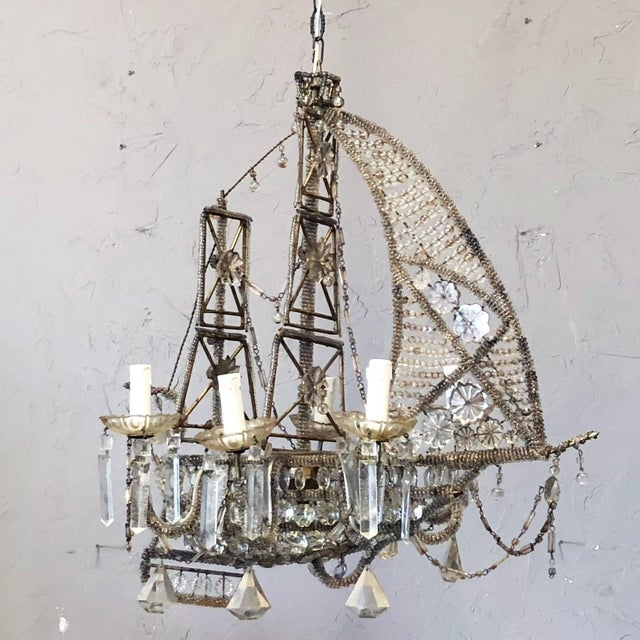 Created in France in 1930 by Maison Baguès, this chandelier is in the shape of a ship with wrapped crystal beads and...