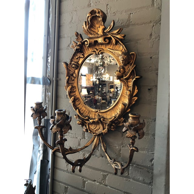 Turn of the Century Gilt Gesso on Hand-carved Wood Frame Girandole Three Light Wall Mirror. The original bevelled oval...