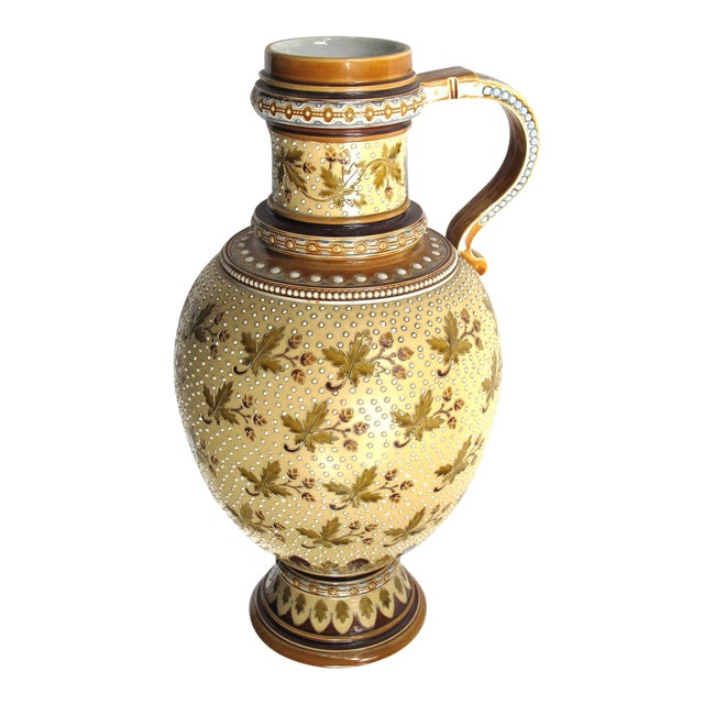 A good quality pair of German Mettlach pottery ewers; each with impressed maker's mark; dated 1893; each heavily potted...
