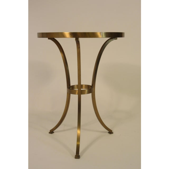 Solid brass gueridon drink table with marble top.