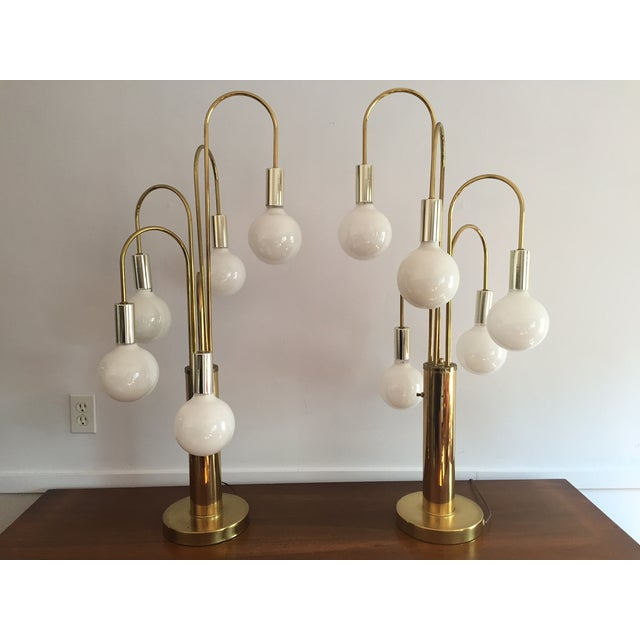 Large pair of amazing mid-century waterfall brass table lamps. So unique. Has three-way switch to illuminate choice of 2,...