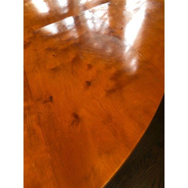Classic 19th century Biedermeier bird's-eye maple round center or side table having gorgeous grain on the single pedestal,...