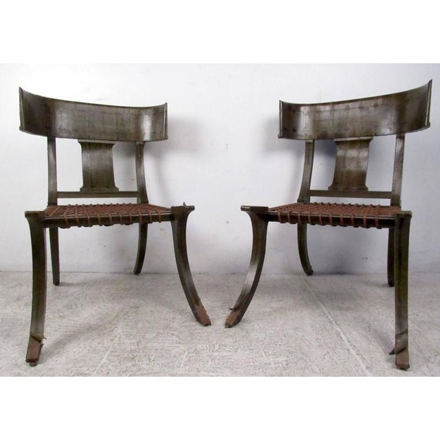 Two vintage-modern chairs featuring beautifully sculpted bodies with snake skin finish. Impressive matched pair of vintage...