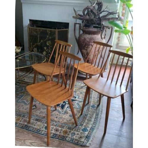 We have a love affair with this beautifully designed chair. A set of four original, spindle back, model J77 dining or side...