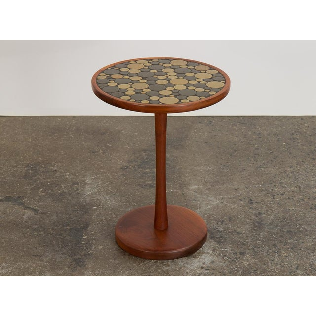 Ceramic coin tile top side table, designed by Jane and Gordon Martz for Marshall Studio. Beautiful turned walnut pedestal...