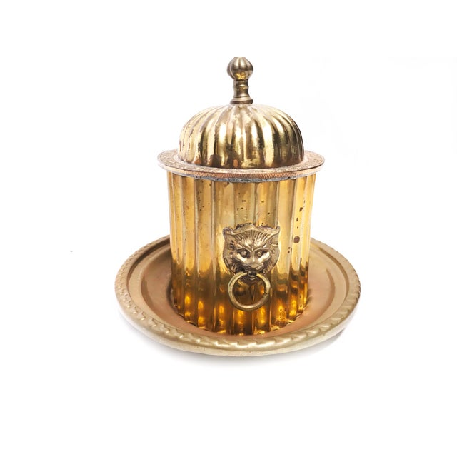 Vintage mid century solid brass trinket box with tray, lion knocker handles, and intricate lid. The set includes a solid...
