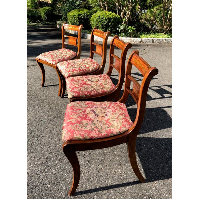 Elegant set of walnut Regency style dining chairs made in England, circa 1920s. Sophisticated lines with sabre legs,...