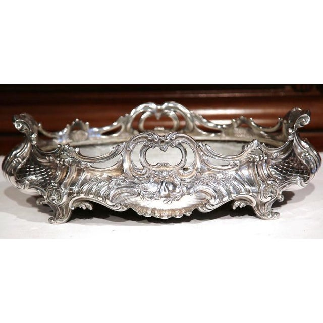 This elegant, silver plated jardinière was created in Paris, France, circa 1850. The large, antique planter sits on four...