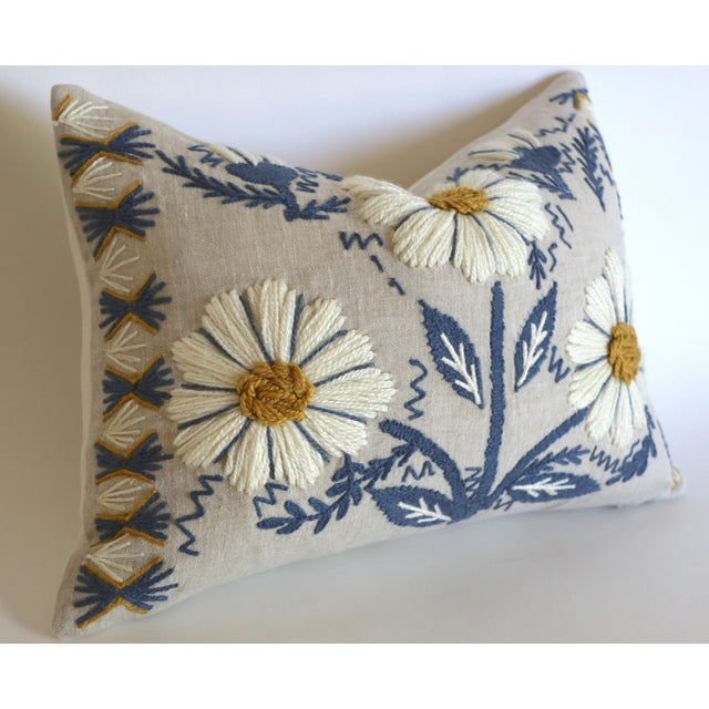 Offered is one Swedish Schumacher Hand Embroidered Pillow Cover in Blue, Ochre, & Natural, with happy ivory daisies hand...