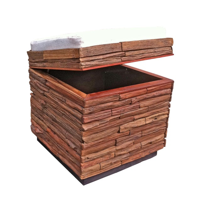 The Lanna Reclaimed Wood Stool has a top that opens allowing access for storage. It can be used with the cotton cushion...