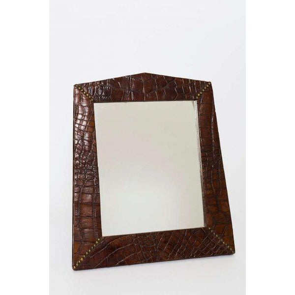 Beautiful Alligator frame inset with a mirror with brass studs on corners.