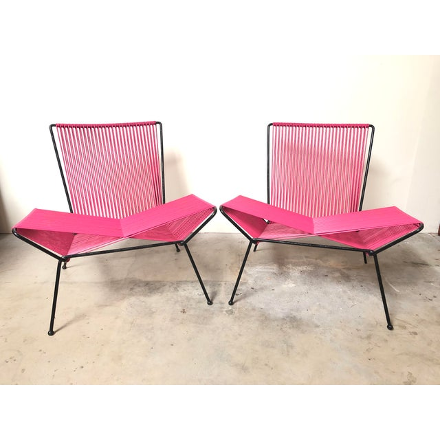 Amazing pair of vintage modernist outdoor lounge chairs. Attributed to designer Allan Gould Hot pink plastic cording on...