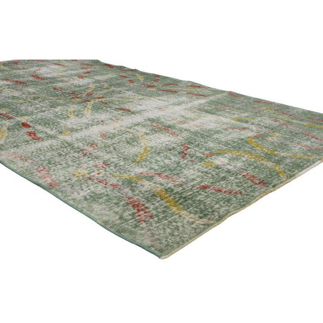 Highlighting some of the finest Art Deco and modern Industrial styles, this distressed vintage Turkish Sivas rug is...