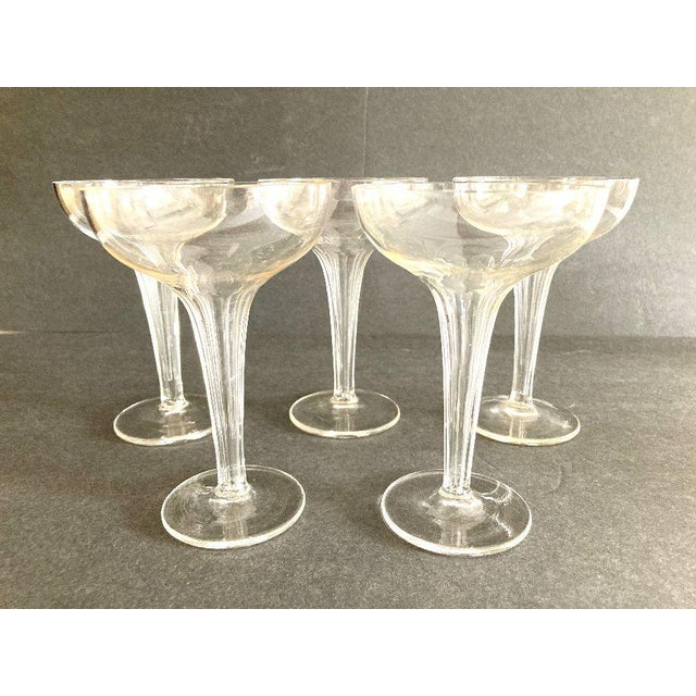 Vintage Midcentury Clear Glass Ribbed Design Hollow Stem Champagne Glasses Set of 5 ,no makers mark, in excellent...
