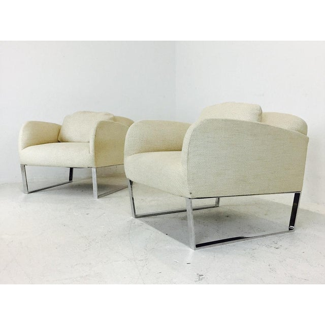 Pair of chrome Donghia Focal deco style lounge chairs in the style of Milo Baughman created by Angelo Donghia. Chairs are...