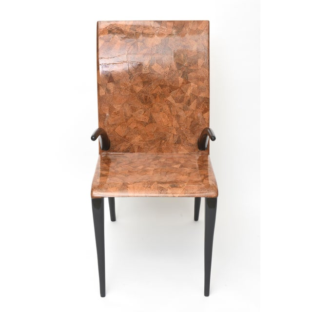 The back and seat of coconut and tobacco under resin, the arms and legs of ebony wood, metal label R & Y Augousti- Paris.
