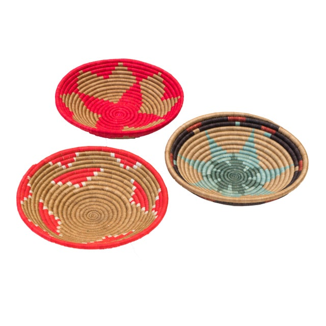 This set of 3 handwoven Rwanda sweetgrass multicolor coil baskets trio is an incredibly special and unique set to add to...