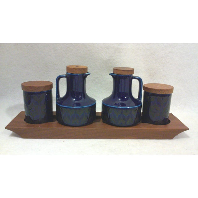 An English ceramic condiment set in vibrant cobalt blue gloss glaze with a black design and teak lids and caddy. This Mid-...