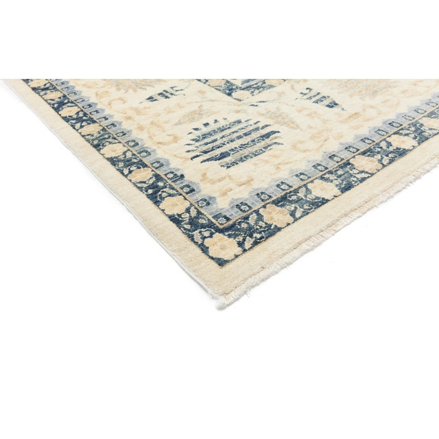 A hand knotted Turkish Oushak inspired area rug. The Turkish city of Oushak was a major rug production center during the...