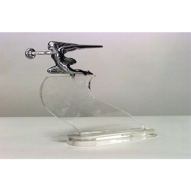 American Art Deco chrome hood ornament/figure of woman with wheel on Lucite base (Goddess of Speed, 1939 - 1942 Parkard,...