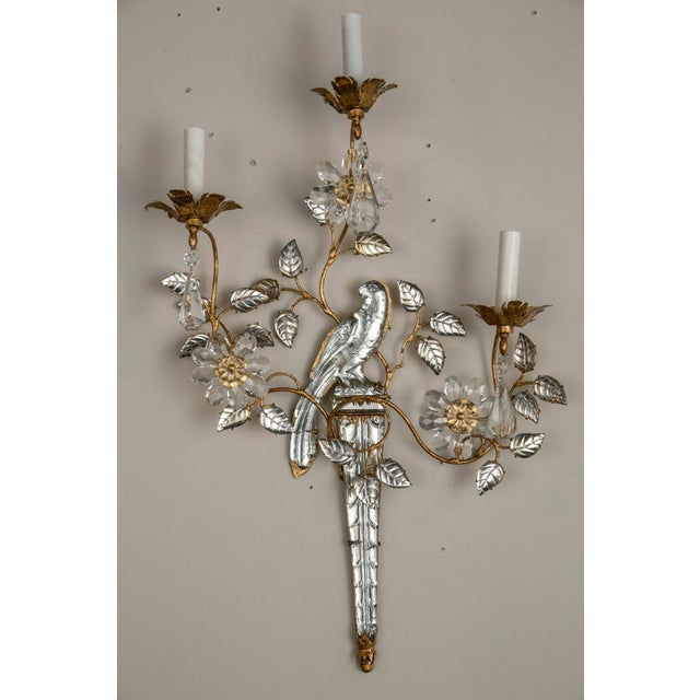 Beautiful three light French sconces gilt and crystal. Sold in pairs, six pair available.