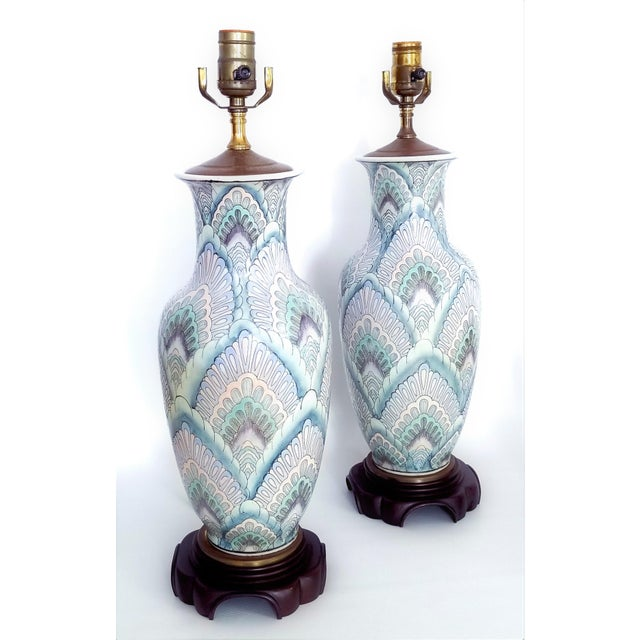 Offering a rare and beautifully colorful pair of vintage Famille Rose ceramic porcelain table lamps, circa 1960s. These...