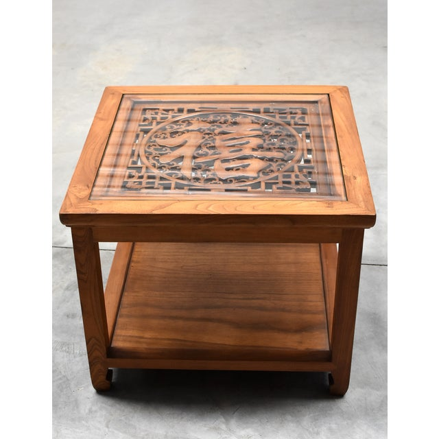 A beautiful natural finish square table made of solid elm wood. The table top is inset with a piece of hand carved screen...