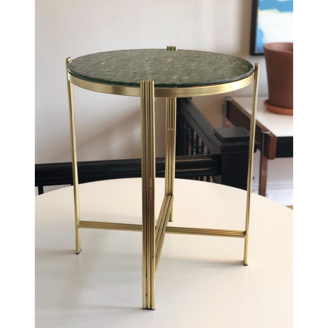 The contrast of the hand laid jade color mosaic glass and the brass is an absolute stunner. Perfect sized accent table for...