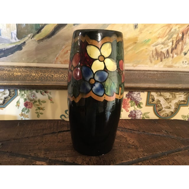 Vintage German made Art Deco style Pottery Vase. Lovely hand painted flowers on black. Some minor wear. Found in Belgium....