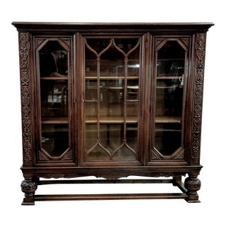 Antique Flemish Renaissance Revival / Jacobean Carved Oak Glazed Bookcase For Sale