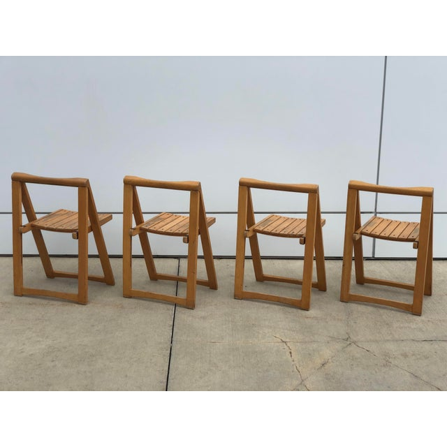 Incredible set of 4 vintage Danish designed folding chairs, as sturdy as they are striking. They can be used in a variety...
