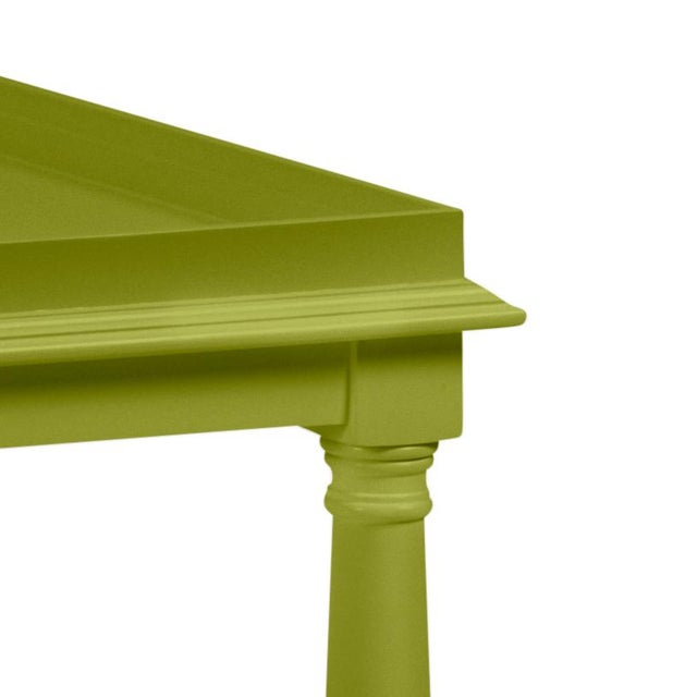 Made of acacia wood, this cocktail table features a gallery shelf and turned legs. Finish is Benjamin Moore Dark Celery.