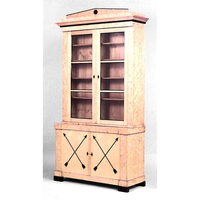 Pair of Swedish Biedermeier ebonized and maple bookcase cabinets with a pair of glazed doors over a pair of doors set with...